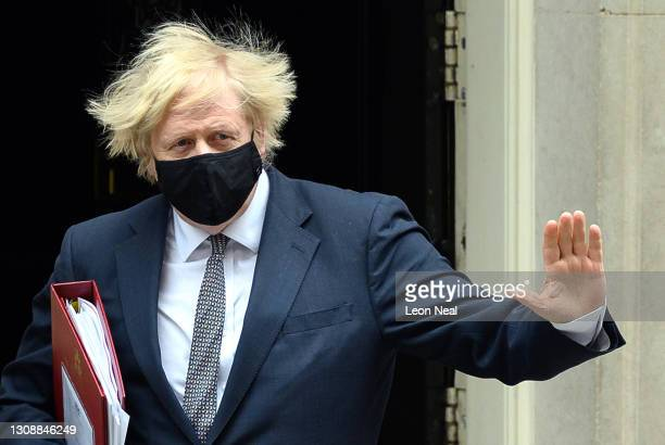 Prime Minister, Boris Johnson leaves number 10, Downing Street as he heads to the House of Commons for the weekly PMQ session on March 24, 2021 in...