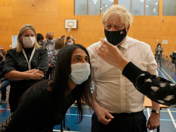 GBR: British Prime Minister Visits A Vaccination Centre In West London