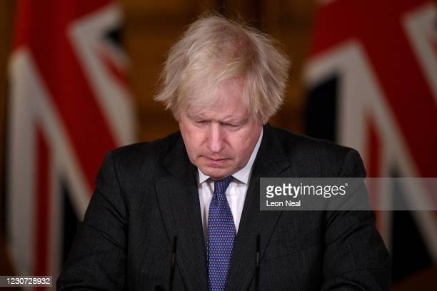 Prime Minister Boris Johnson looks down during a coronavirus press conference at 10 Downing Street on January 22, 2021 in London, England. The Prime...