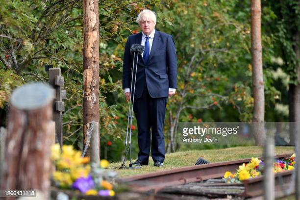 Prime Minister Boris Johnson makes a speech during a national service of remembrance, marking the 75th Anniversary of VJ Day, at The National...