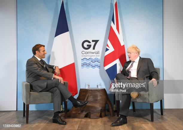 Prime Minister Boris Johnson meets French President Emmanuel Macron, ahead of a bilateral meeting during the G7 summit in Carbis Bay, during the G7...