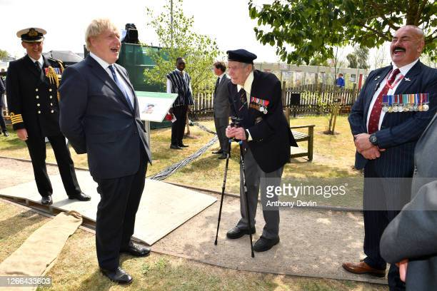 Prime Minister Boris Johnson meets veteran Bill Redston following a national service of remembrance marking the 75th Anniversary of VJ Day at The...