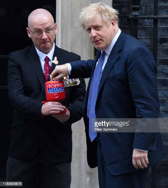 Prime Minister Boris Johnson meets with fundraisers for the Royal British Legion and purchases a poppy outside Downing Street on October 28 2019 in...