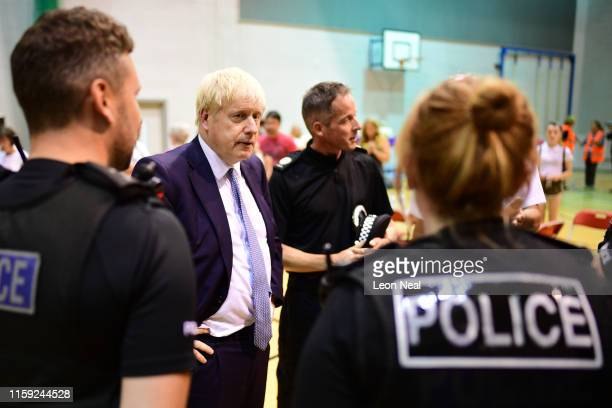 Prime Minister Boris Johnson meets with rescue crews and local residents at ChapelenLefrith High School as work continues at Toddbrook reservoir...