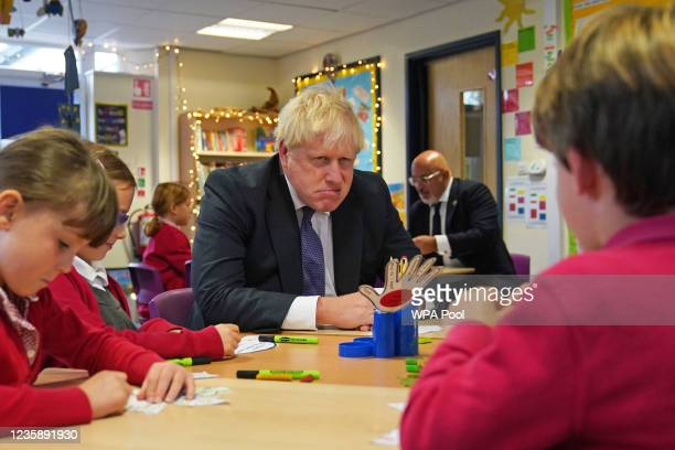 Prime Minister Boris Johnson meets with school children during a visit to Westbury-On-Trym Church of England Academy, prior to a regional cabinet...