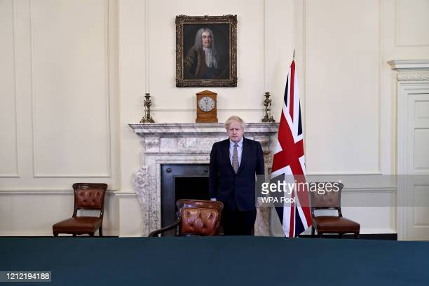 Prime Minister Boris Johnson observes a two-minute silence to commemorate the seventy-fifth anniversary of VE Day at Downing Street on May 8 in...
