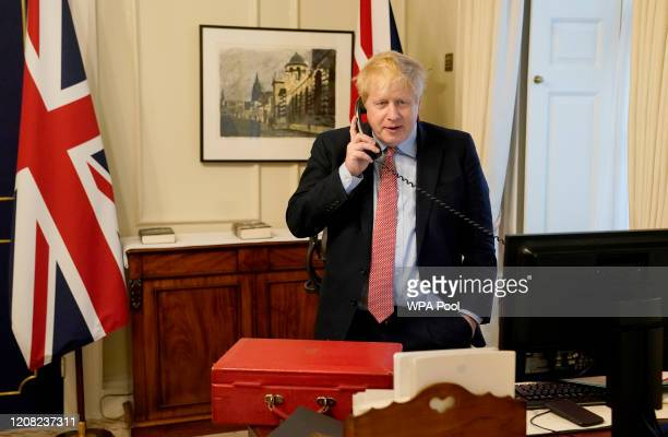 Prime Minister Boris Johnson on the telephone to Queen Elizabeth II for her Weekly Audience during the coronavirus pandemic at 10 Downing Street on...