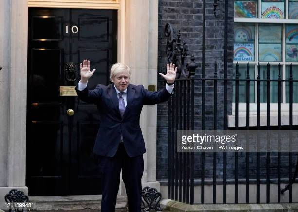 Prime Minister Boris Johnson outside 10 Downing Street in London joins in the applause to salute local heroes during Thursday's nationwide Clap for...