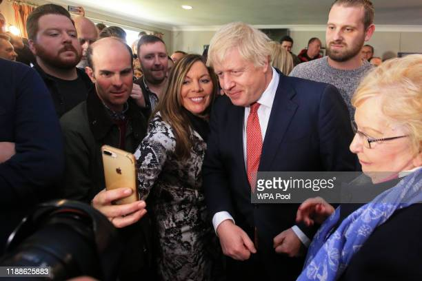 Prime Minister Boris Johnson poses for a selfie with supporters on a visit to meet newly elected Conservative party MP for Sedgefield, Paul Howell at...