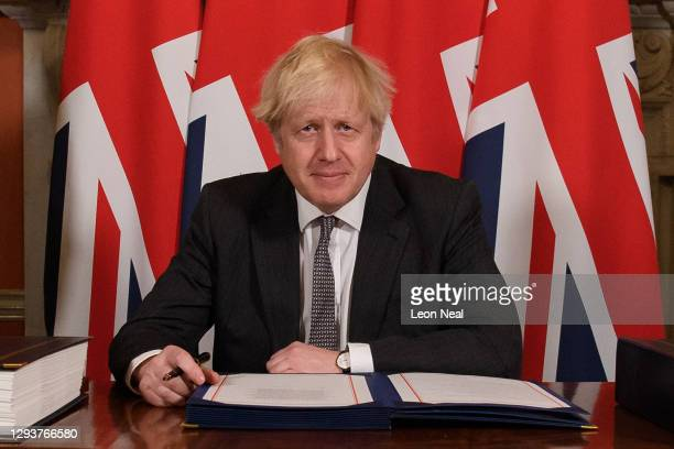 Prime Minister, Boris Johnson poses for photographs after signing the Brexit trade deal with the EU in number 10 Downing Street on December 30, 2020...