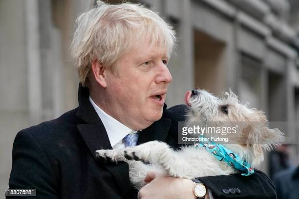 Prime Minister Boris Johnson poses outside Methodist Hall polling station as he cast his vote with dog Dilyn on December 12 2019 in London England...