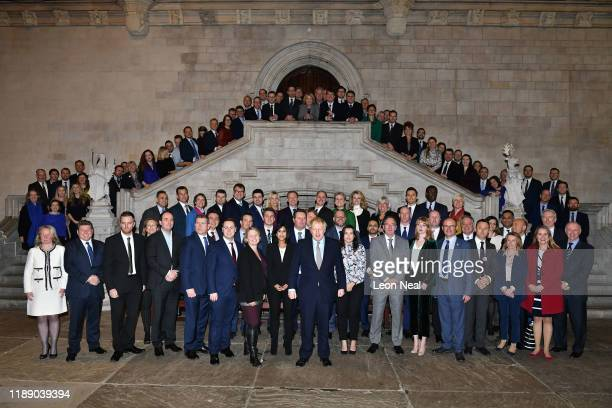 Prime Minister Boris Johnson poses with newlyelected Conservative MPs at the Houses of Parliament on December 16 2019 in London England Boris Johnson...