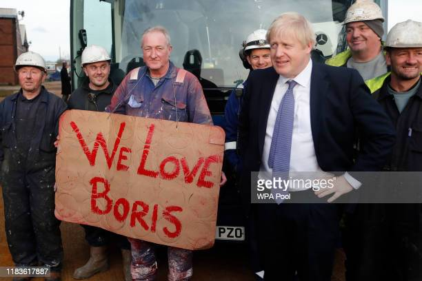 Prime Minister Boris Johnson poses with workers as he is given a tour during a visit to Wilton Engineering Services as part of a General Election...