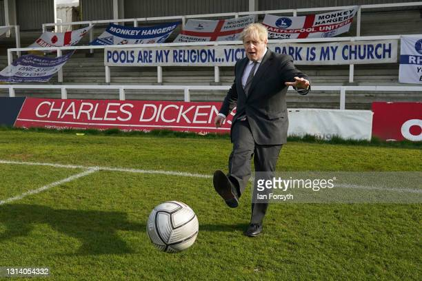 Prime Minister Boris Johnson practices his football skills as he visits Hartlepool United Football Club on April 23, 2021 in Hartlepool, England. The...