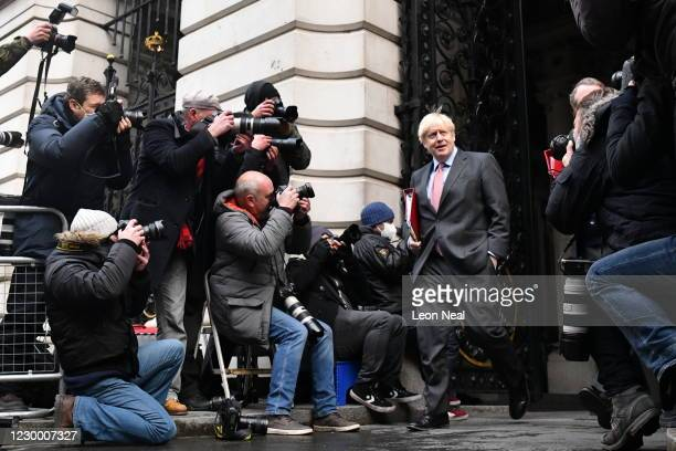 Prime Minister Boris Johnson returns to Downing Street following a cabinet meeting on December 8, 2020 in London, England. The meeting came on the...