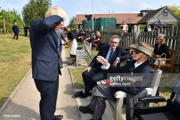 Prime Minister Boris Johnson salutes as he meets veteran Wynne Fairhead following a national service of remembrance marking the 75th Anniversary of...
