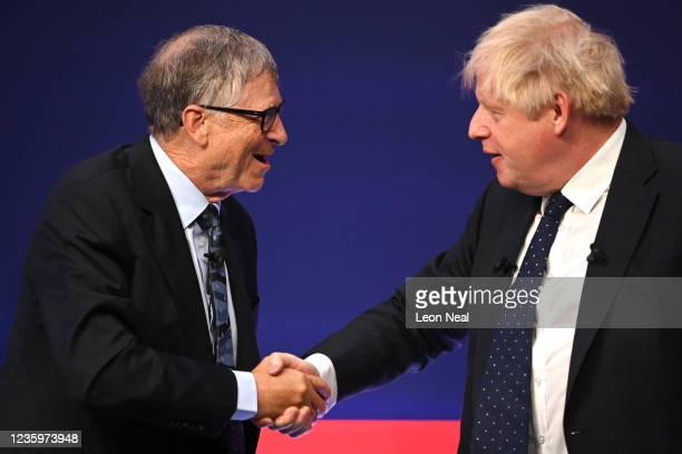 Prime Minister Boris Johnson shakes hands with American Businessman Bill Gates during the Global Investment Summit at the Science Museum on October...