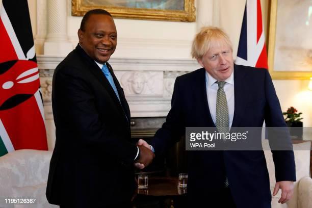 Prime Minister Boris Johnson shakes hands with President of Kenya Uhuru Kenyatta at 10 Downing Street on January 21 2020 in London England