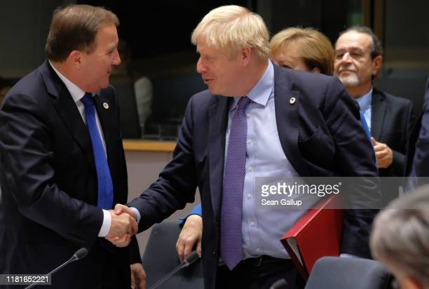 Prime Minister Boris Johnson shakes hands with Swedish Prime Minister Stefan Löfven at a summit of European Union leaders on October 17, 2019 in...