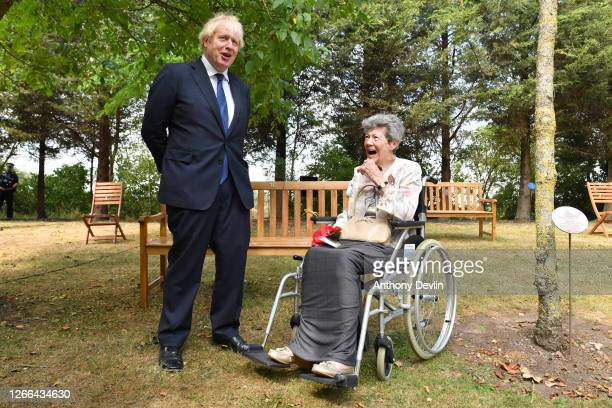 Prime Minister Boris Johnson shares a laugh with veteran Joan Birfiled after she refused to tell him her role in the War due to the official secrets...