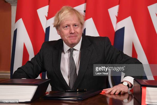 Prime Minister, Boris Johnson signs the Brexit trade deal with the EU in number 10 Downing Street on December 30, 2020 in London, United Kingdom. The...