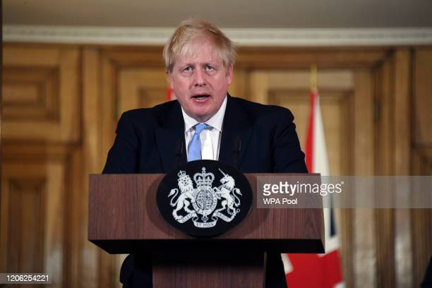 Prime Minister Boris Johnson speaks and takes questions during a press conference in Downing Street regarding the coronavirus outbreak, on March 9,...