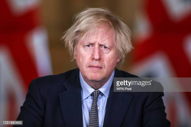 Prime Minister Boris Johnson speaks during a press conference at 10 Downing Street on March 23, 2021 in London, England. The UK held a Day of...