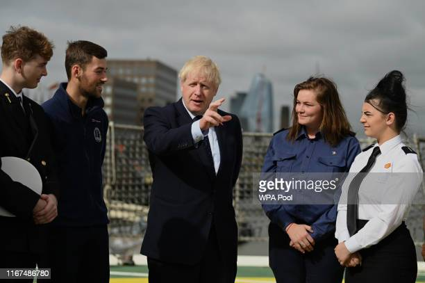 K Prime Minister Boris Johnson speaks to apprentices as he visits the NLV Pharos a lighthouse tender moored on the river Thames to mark London...