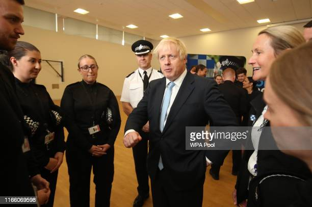 Prime Minister Boris Johnson speaks to police officers during a visit on September 05 2019 in West Yorkshire United Kingdom The government promised...