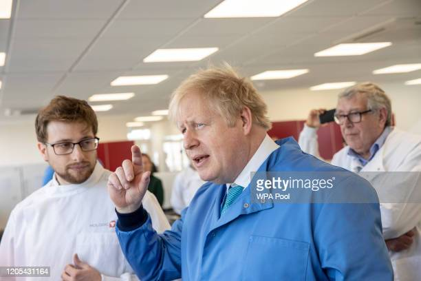 Prime Minister Boris Johnson speaks to staff during a visit to the Mologic Laboratory in the Bedford technology Park on March 06 2020 in Bedford...