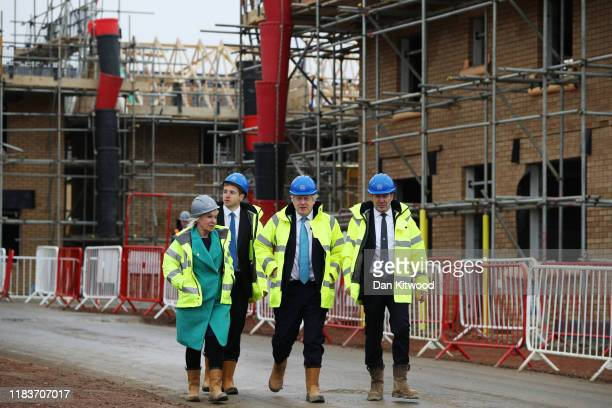 Prime Minister Boris Johnson speaks with Andrew Swindell Regional Director of Barratt Homes and Health minister and Conservative MP Nadine Dorries...