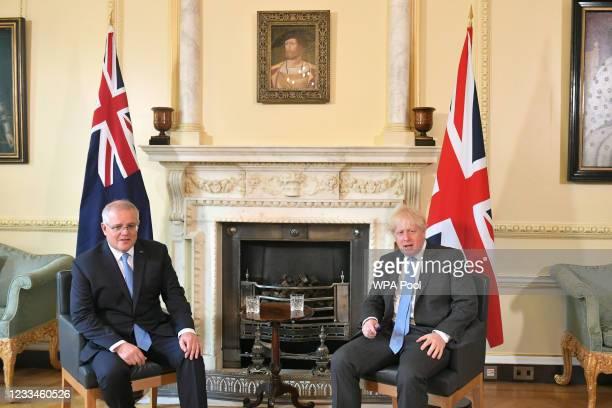 Prime Minister Boris Johnson speaks with Australian Prime Minister Scott Morrison ahead of a meeting to formally announce a trade deal with the UK,...