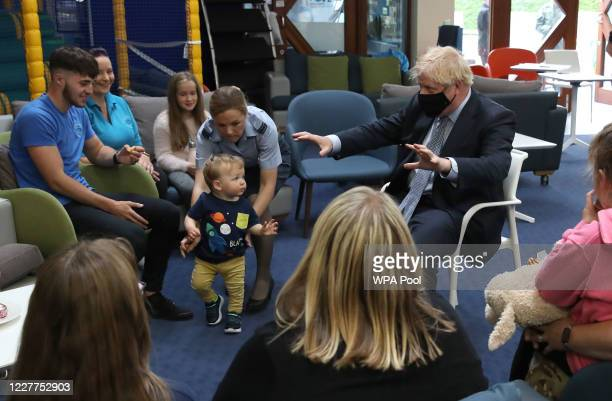 Prime Minister Boris Johnson speaks with families in the community centre at RAF Lossiemouth, Moray, during a visit to the Highlands and Northern...
