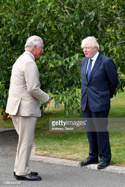 Prime Minister Boris Johnson speaks with Prince Charles Prince of Wales following a national service of remembrance marking the 75th Anniversary of...