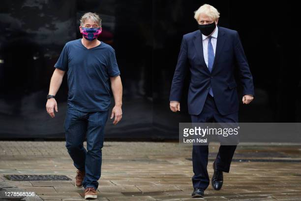 Prime Minister Boris Johnson stands with the founder and CEO of Octopus Energy Greg Jackson as he visits the headquarters of Octopus Energy on...