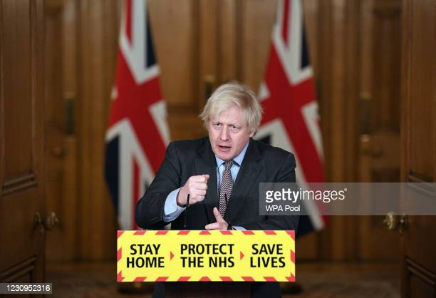Prime Minister Boris Johnson takes part in a media briefing in Downing Street on February 3, 2021 in London, England. The UK has now administered in...