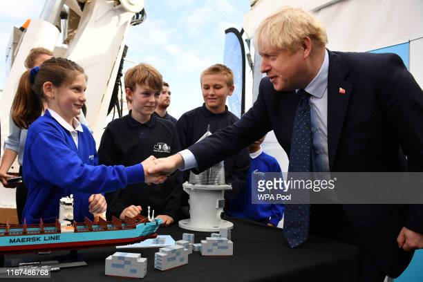 K Prime Minister Boris Johnson takes part in an activity with school children as he visits the NLV Pharos a lighthouse tender moored on the river...