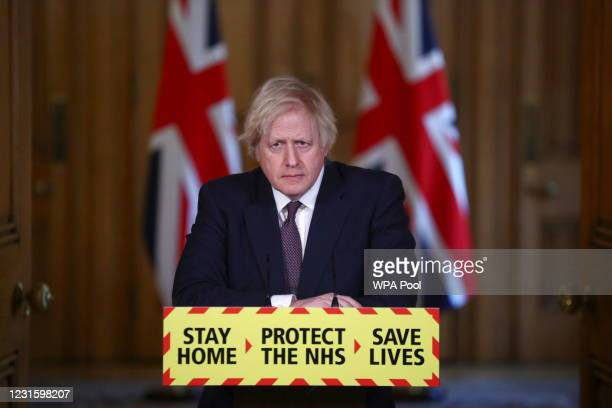 Prime minister Boris Johnson talks at a Covid-19 news conference at 10 Downing Street on March 8, 2021 in London, England.
