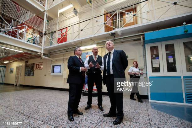 Prime Minister Boris Johnson talks with HMP Leeds governor Steve Robson and Justice Secretary Robert Buckland during a visit to Leeds prison on...