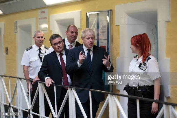 Prime Minister Boris Johnson talks with prison staff during a visit to Leeds prison on August 13 2019 in Leeds England In an announcement on Sunday...
