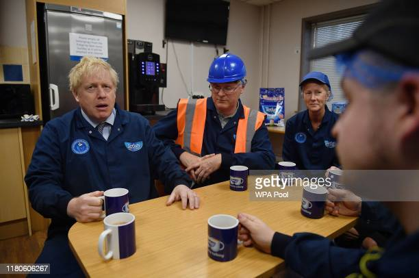 Prime Minister Boris Johnson talks with workers during a general election campaign visit to the Tetley Tea Factory at Tata Global Beverages on...
