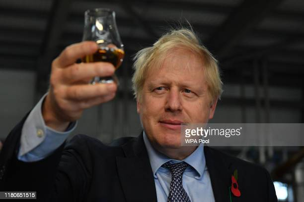 Prime Minister Boris Johnson tastes whisky during a general election campaign visit to Diageo's Roseisle Distillery on November 07, 2019 near Elgin...