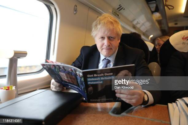 Prime minister Boris Johnson travels on a train to Telford ahead of delivering the Conservative Party election manifesto later today on November 24...