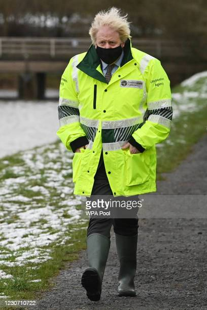 Prime Minister Boris Johnson visits a storm basin near the River Mersey in Didsbury on January 21, 2021 in Manchester, England. A major incident has...