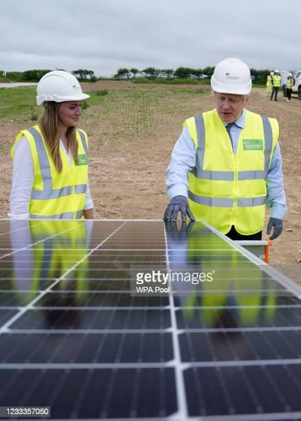 Prime minister Boris Johnson visits the Scottish Power Carland Cross Windfarm on June 9, 2021 in Newquay, Cornwall, England. UK prime minister Boris...