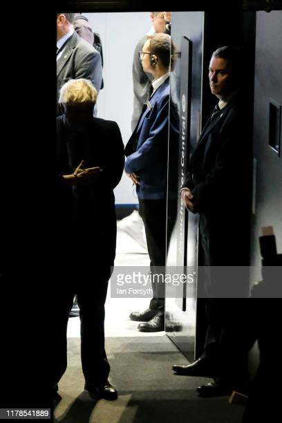 Prime Minister Boris Johnson waits to be introduced to deliver his keynote speech on the final day of the Conservative Party Conference at Manchester...