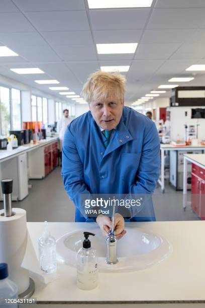 Prime Minister Boris Johnson washes his hands during a visit to the Mologic Laboratory in the Bedford technology Park on March 06, 2020 in Bedford,...