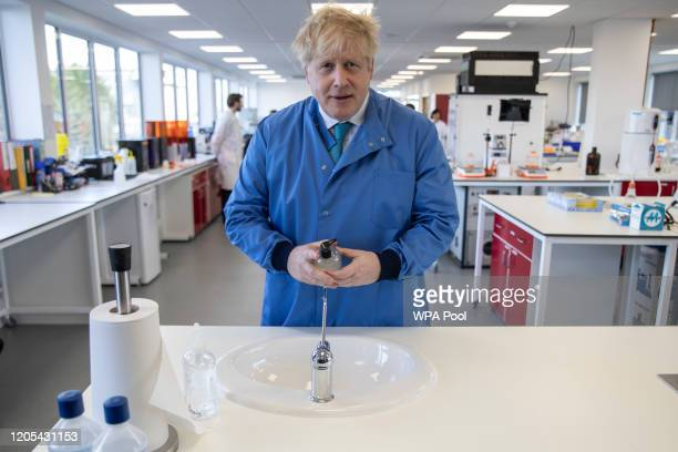Prime Minister Boris Johnson washes his hands during a visit to the Mologic Laboratory in the Bedford technology Park on March 06 2020 in Bedford...