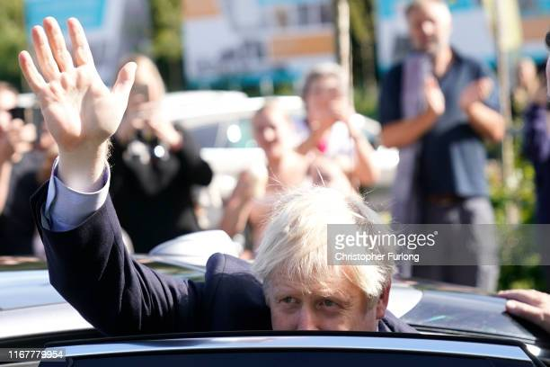 Prime Minister Boris Johnson waves as he leaves Fox Valley Shopping Park on September 13 2019 in Sheffield England The Convention brings together the...