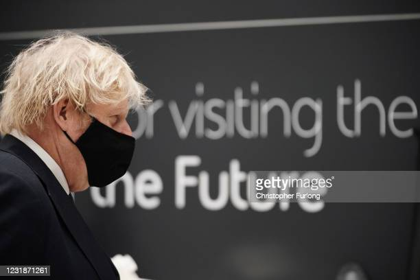 Prime minister Boris Johnson wearing a face mask during a visit to BAE Systems at Warton Aerodrome on March 22, 2021 in Preston, England. The prime...